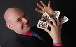 Magician David Fox performing a card flourish at a wedding in the Midlands.