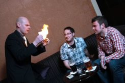 David Fox entertaining two gentlemen with close-up fire magic.
