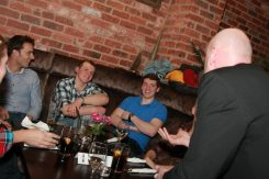Three gentlemen enjoying an amazing close-up trick.