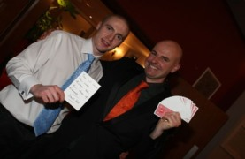 Photo Of David Fox Magician Performing Magic At A Party